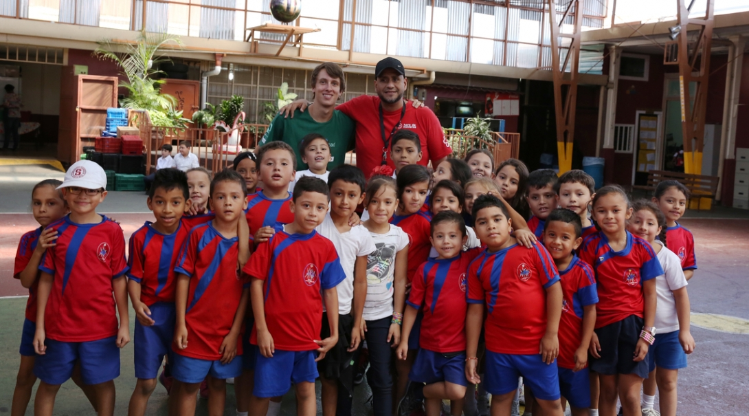 A volunteer poses with his team on a sports placement in Costa Rica